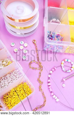 Creative Flatlay Of Different Pearl Beads With Tools For Making Jewelry, Wire String And Scissors Is