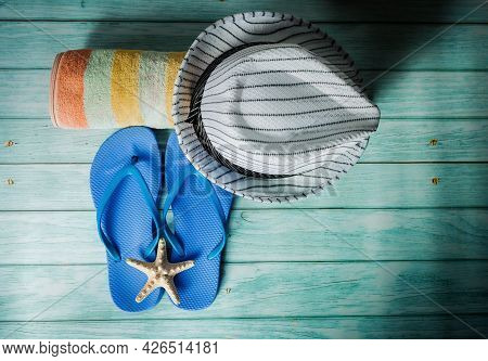 Sea Season - Hat, Flip-flops, Towel. Vacation And Travel Time