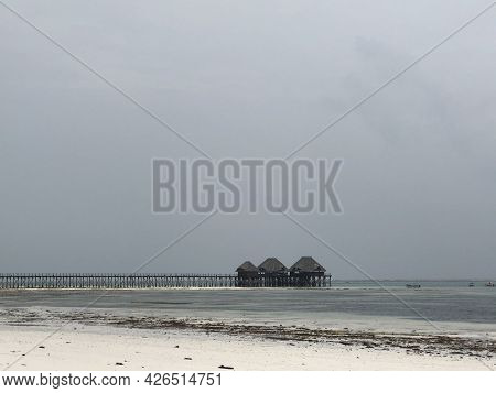 Indian Ocean Coast. Wooden Houses On Stilts In The Ebb And Flow. Zanzibar Island. Africa. Typical Vi