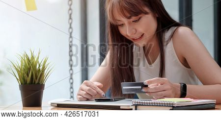 Smiling Woman Use Mobile Phone For Shopping Online With Credit Card
