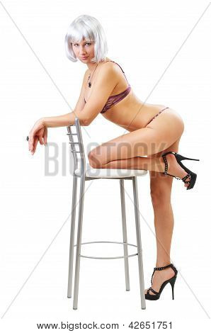 Sexy Woman Kneeling On The Chair