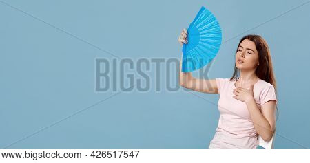 Sweaty Beautiful Lady With Closed Eyes Cooling With Hand Fan