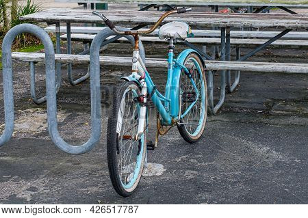 New Orleans, La - July 6: Old Beat Up Bicycle Locked To Bike Rack On July 6, 2021 In New Orleans, Lo