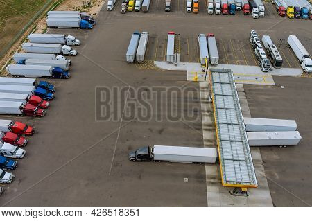 Resting Place The Truck Stop Various Types Of Trucks In Parking Lot The Highway With Gas Station For