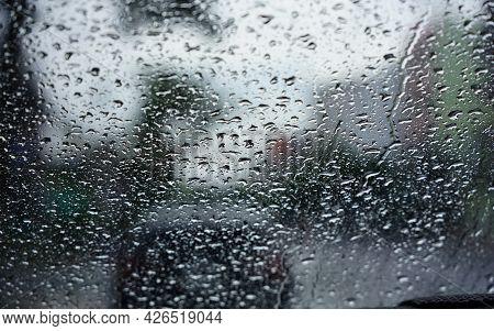 The Rain Drops Seen Through The Windshield During The Evening Rain