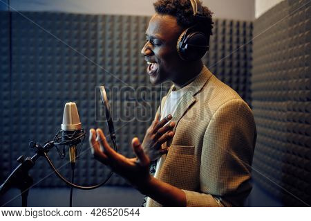 Male singer sings a song, recording studio
