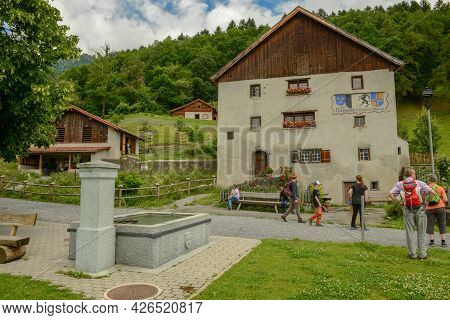 People Visiting The Village Of Heidi Over Maienfeld On The Swiss Alps