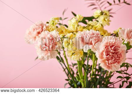 Bouquet Of Pink Carnations And Yellow Matthiola With Green Branches. Design Concept Of Holiday Greet