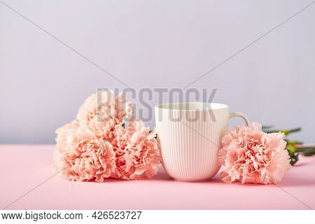 Bouquet Of Pink Carnations And White Cup. Design Concept Of Holiday Greeting With Carnation Bouquet