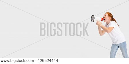 Portrait Of Cute Freckled Red-headed Girl In Casual Outfit Posing Isolated On White Studio Backgroun