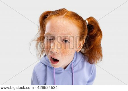 Close-up Funny Girl With Freckled Face And Red Hair Looking At Camera Isolated On White Studio Backg