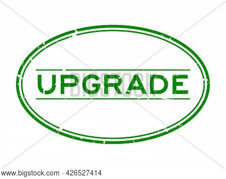 Grunge Green Upgrade Word Oval Rubber Seal Stamp On White Background
