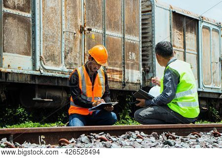 Inspector Engineering Wearing Helmet And Vest Worker Unifrom Checking Railway Construction Work On R
