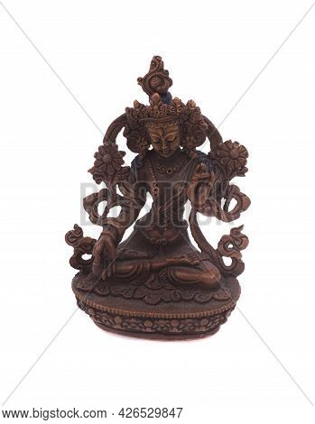 A White Tara Statue Photographed Against A White Background