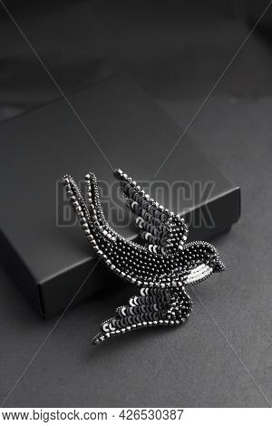 Seed Bead Embroidered Brooch In A Shape Of Black Swallow Bird On Black Background