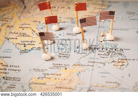 Flags Of China And The United States On A Map Of The South China Sea. Concept Of The South China Sea