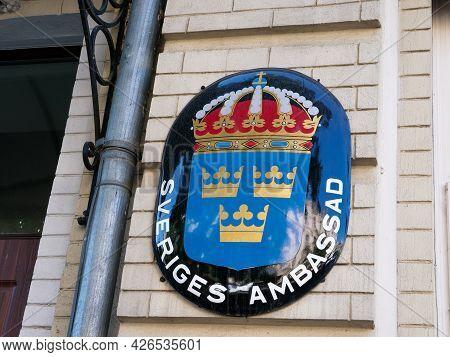 Kyiv, Ukraine - July 07, 2021. Sveriges Ambassad. Coat Of Arms On The Wall Of The Swedish Embassy.