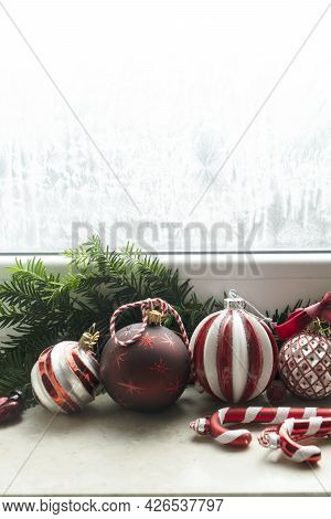 Christmas Red And White Decorations On Windowsil