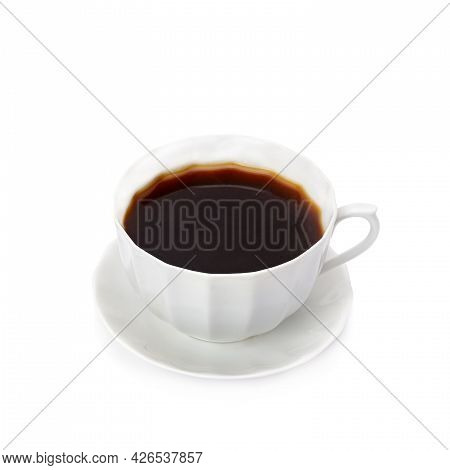 Coffee In A Porcelain Cup Isolated On A White Background.