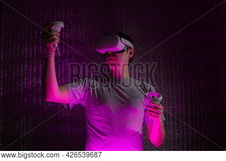 Young Caucasian Man 25-30 Years Using Virtual Reality Headset. Vr, Future, Gadgets, Technology Conce