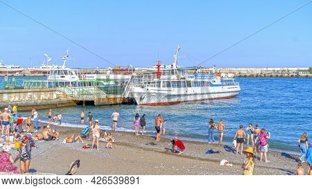 Yalta, Crimea-june 8, 2021: Urban Landscape With A View Of The Embankment. People Are Walking By The