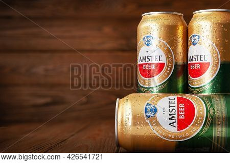 Amstel Beer Cans With Water Drops. Beer In Cans Covered With Condensation. World Famous Dutch Brand.