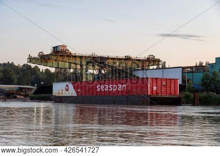 Surrey, Greater Vancouver, British Columbia, Canada - July 7, 2021: Container Barge Loaded At A Mill