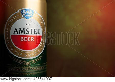 Beer Can. Amstel Beer Close-up On An Abstract Background With Copy Space. An Internationally Renowne