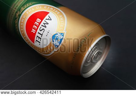 Beer Can. Amstel Beer In A Can Close-up Lies On A Black Background. An Internationally Renowned Bran