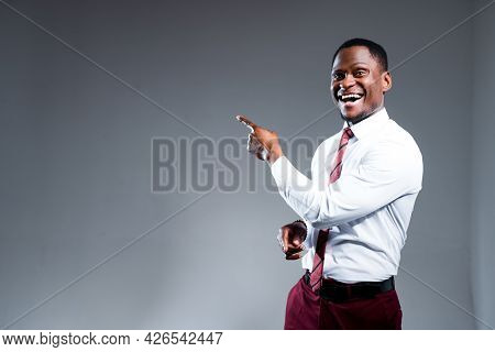 Cheerful African American Man In Shirt Smiling Cheerfully And Showing With Hands To The Side