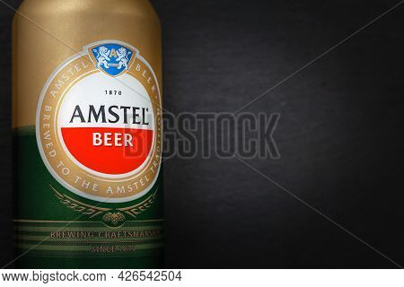 Beer Can. Amstel Beer In Can Close-up On A Black Background With Copy Space. The World-famous Brand