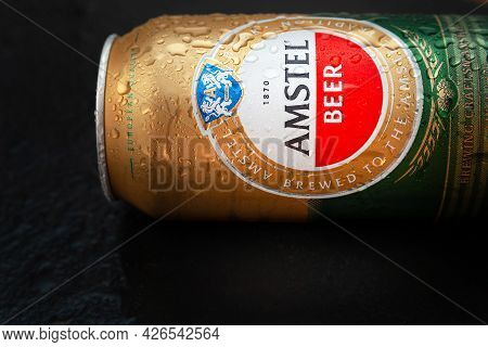 Beer Can With Water Drops. Amstel Beer In A Can Covered With Condensation. World Famous Dutch Brand.