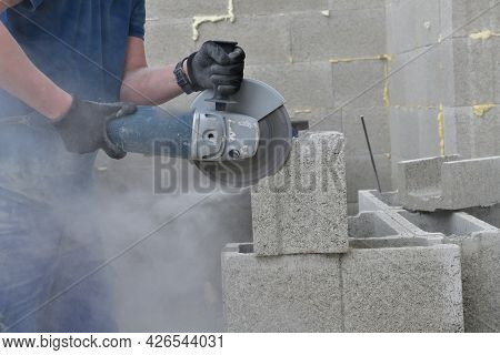 Detail On A High-speed Grinding Wheel During Sawing Of A Block On A Construction Site