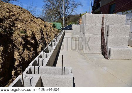 Masonry Building Foundations Of Walls Near The House With A Pile Of Dredged Soil Around