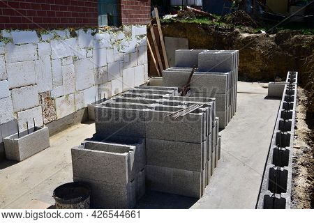 Concrete Walls Built Of Blocks On The Construction Site Of The House