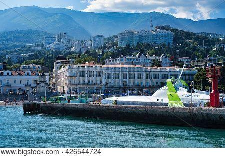 Yalta, Crimea-june 11, 2021: Seascape With A Pleasure Ship On The Background Of Yalta