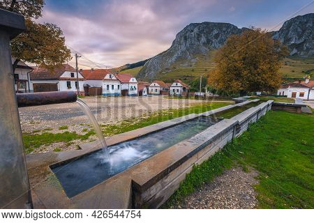 Amazing Rural Street With Traditional Houses In Row And Fountain In The Village Center. Torocko Vill