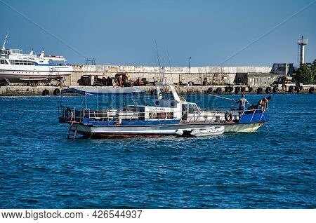 Yalta, Crimea-june 8, 2021: Seascape With A View Of The Boat On The Background Of The Pier And The L