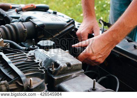 Auto Mechanic Working On Car Engine In Mechanics Garage. Repair Service. Close Up Of Car Mechanic Re