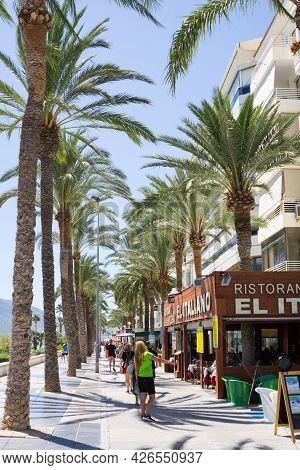 Calpe Spain- August 24 2016; Typically Mediterranean Street In Tourist Coastal Town People Walking A