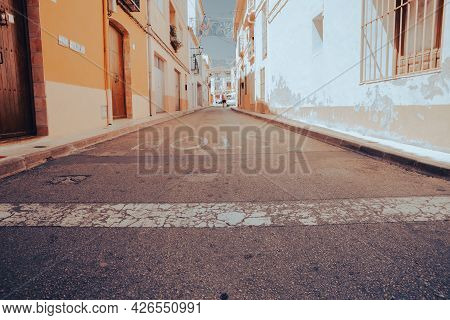 Alcalali Spain- August 23 2016; Village Street In Old Spanish Town With Grungy Building Exteriors Li