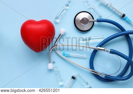 Red Heart With Stethoscope, Syringe And Transparent Ampoules Heart Health Insurance For Your Health