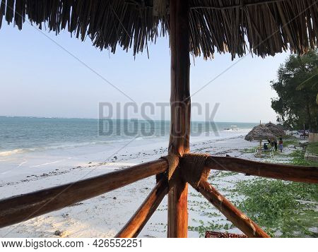 A View Of The Indian Ocean Coastline From A Wooden House On Stilts In High And Low Tide. Zanzibar Is