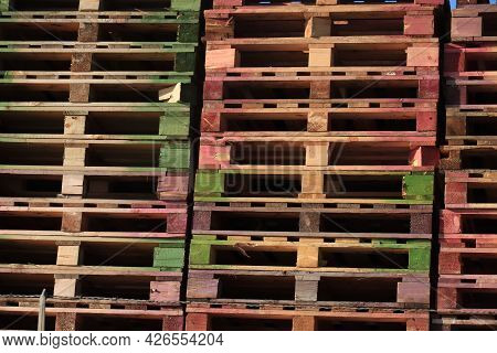 Stacked Wooden Pallets At A Pallet Warehouse