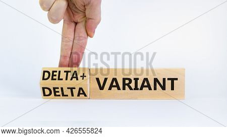 Covid-19 Delta Plus Variant Symbol. Doctor Turns Wooden Cubes, Changes Words Delta Variant To Delta