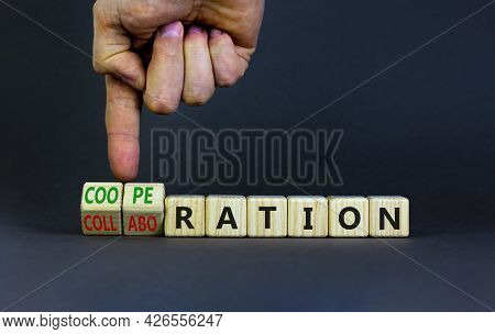 Cooperation Or Collaboration Symbol. Businessman Turns Cubes, Changes Words 'collaboration' To 'coop