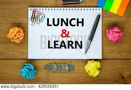 Lunch And Learn Symbol. Words 'lunch And Learn' On White Note. Wooden Table, Colored Paper, Paper Cl