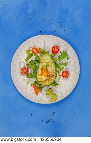 Scrambled Eggs In Avocado, An Original Nutritious Snack For A Balanced Diet. Served With Vegetable S