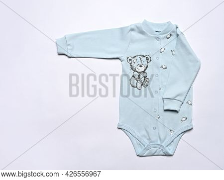 Layout Flat Lay Baby Bodysuit On A Light Background. Mockup For Design And Placement Of Logos, Adver