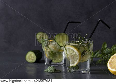 Summer Fresh Iced Drink With Mint, Lemon And Cucumber, Healthy Detox Mojito Cocktail On Dark Gray Ba